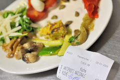 Antipasti dish and receipt Stock Image