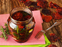 Antipasti with dried tomatoes. Homemade sun dried tomatoes in olive oil Stock Images