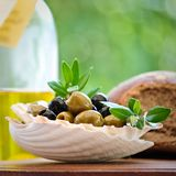 Antipasti - green and black olives Stock Photos