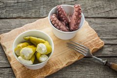 Antipasti green hot pepper with pulpo Stock Photo