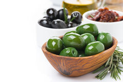 Antipasti - olives, pickles, olive oil, fresh rosemary. And ciabatta, isolated on white Royalty Free Stock Photos