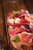 Antipasti Platter of Cured Meat,   jamon, olives, sausage, salam Stock Image