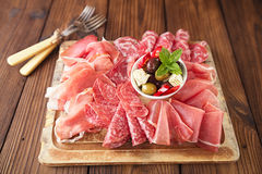 Antipasti Platter of Cured Meat,   jamon, olives, sausage, salam Royalty Free Stock Images