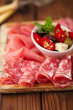 Antipasti Platter of Cured Meat,   jamon, olives, sausage, salam Royalty Free Stock Image