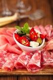 Antipasti Platter of Cured Meat,   jamon, olives, sausage, salam Stock Photos