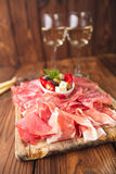 Antipasti Platter of Cured Meat,   jamon, olives, sausage, salam Royalty Free Stock Photo