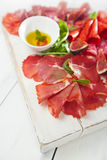 Antipasti Platter of Cured Meat,   jamon, sausage, salame on whi Royalty Free Stock Photos