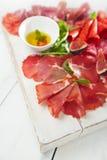 Antipasti Platter of Cured Meat,   jamon, sausage, salame on whi Royalty Free Stock Photos
