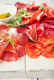 Antipasti Platter of Cured Meat,   jamon, sausage, salame on whi Stock Images
