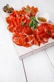 Antipasti Platter of Cured Meat,   jamon, sausage, salame on whi Royalty Free Stock Image