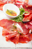 Antipasti Platter of Cured Meat,   jamon, sausage, salame on whi Royalty Free Stock Photo