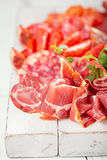 Antipasti Platter of Cured Meat,   jamon, sausage, salame on whi Stock Photography
