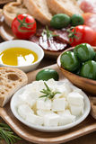 antipasti platter - fresh feta cheese, deli meats, olives Stock Image