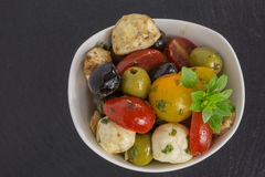 Antipasti salad with tomatoes and olives Royalty Free Stock Images