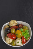 Antipasti salad with tomatoes and olives Royalty Free Stock Image
