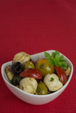 Antipasti salad with tomatoes and olives Stock Photos