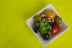 Antipasti salad with tomatoes and olives Stock Image