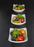 Antipasti salad with tomatoes and olives. Mediterranean antipasti salad with mozzarella balls, green and black olives and cherry tomatoes and some tiny-leafed stock images