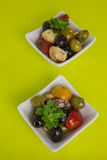 Antipasti salad with tomatoes and olives. Mediterranean antipasti salad with mozzarella balls, green and black olives and cherry tomatoes and some tiny-leafed royalty free stock photography