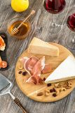 Antipasti set, cheese, jamon, nuts, honey and red wine Stock Photos