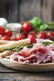Antipasto με το ζαμπόν και το πράσινο σπαράγγι Στοκ Εικόνα