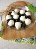 Antipasto with black olives and mozzarella balls in olive oil Royalty Free Stock Image