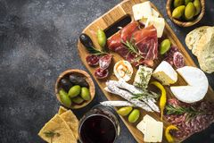 Antipasto board with sliced meat, ham, salami, cheese, olives an royalty free stock image