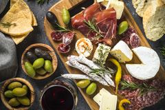 Antipasto board with sliced meat, ham, salami, cheese, olives an royalty free stock photography