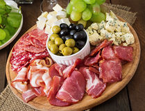 Antipasto catering platter with bacon, jerky, salami, cheese and grapes Royalty Free Stock Image