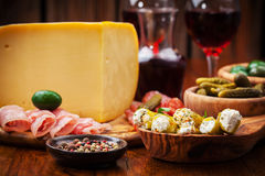 Antipasto catering platter with cheese loaf Royalty Free Stock Images