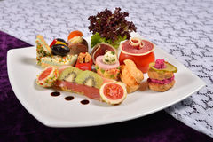 Antipasto and catering platter with different appetizers (fruits Royalty Free Stock Images