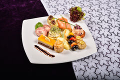 Antipasto and catering platter with different appetizers(fruits, Royalty Free Stock Photography