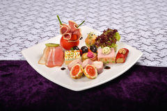 Antipasto and catering platter with different appetizers(fruits, Stock Photography
