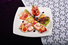Antipasto and catering platter with different appetizers(fruits, Royalty Free Stock Photo