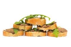 Antipasto. De plakken van de pastei, van arugula en van baguette stock afbeeldingen