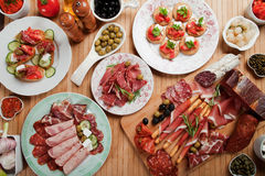 Antipasto food. Prosciutto di Parma, various canape snacks and appetizers Royalty Free Stock Image