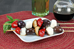 Antipasto kabobs with olives, garlic, roasted peppers and mozza Stock Images