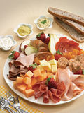 Antipasto of meat, cheese and fruit Royalty Free Stock Photos