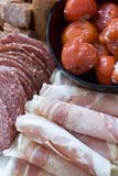 Antipasto; meats and stuffed peppers Stock Photo