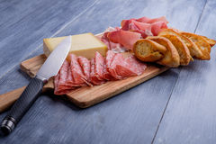 Antipasto plate with cheese Royalty Free Stock Photo