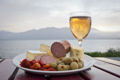 Antipasto plate by the sea Royalty Free Stock Images