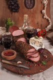 Antipasto platter with different meat and cheese Royalty Free Stock Images