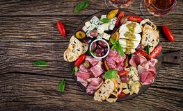 Free Antipasto Platter With Ham, Prosciutto, Salami, Blue Cheese, Mozzarella With Pesto And Olives Royalty Free Stock Photography - 155892127