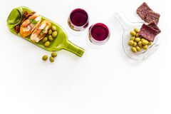 Antipasto and red wine in glasses top-down copy space