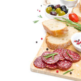 Antipasto - salami, bread, olives, tomatoes isolated on white Royalty Free Stock Photography