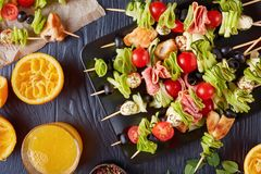 Antipasto skewers with meat and veggies stock image