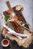 Antipasto traditional spanish meat snack with bread and herbs Stock Photos
