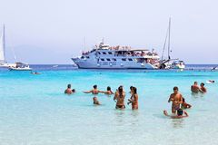 Tourists at Voutoumi beach Antipaxos island Greece royalty free stock photo