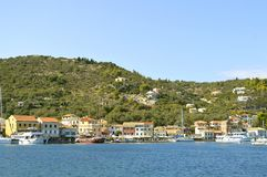 Antipaxos harbour tourist cruise ships Royalty Free Stock Photo