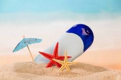 Antiperspirant, starfishes and umbrella Royalty Free Stock Image